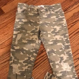 Distressed army fatigue jeans